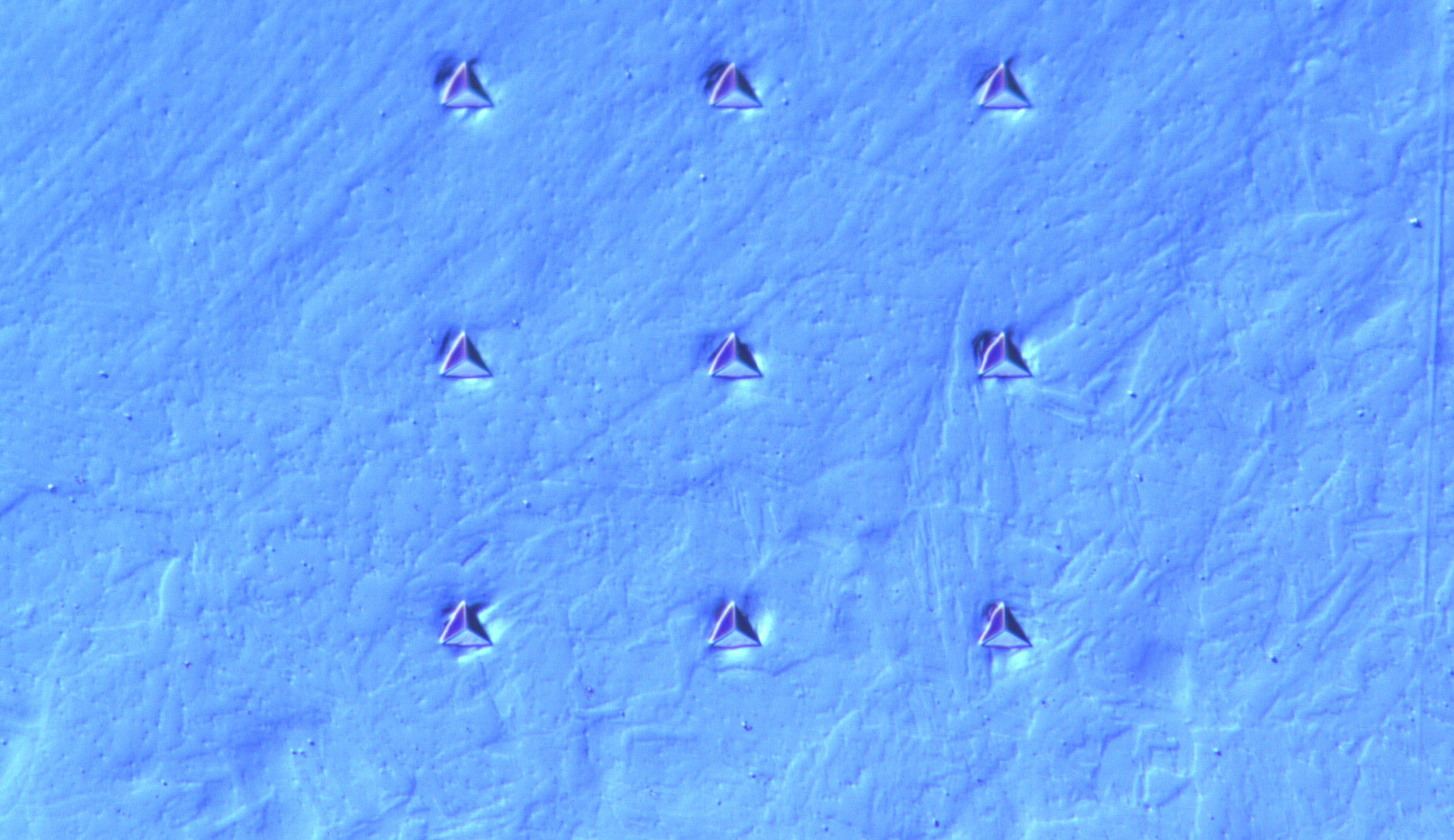Array of indents in an ion-irradiated T91 steel viewed by optical microscopy